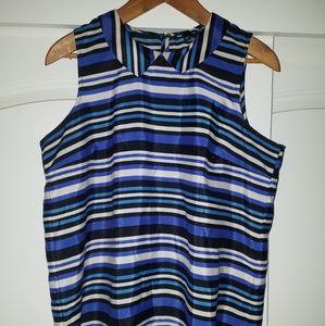 Blue, black and white stripped sleeveless shirt.